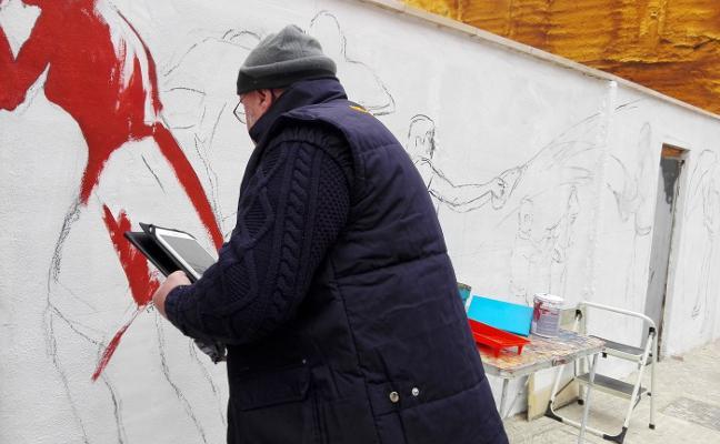 Uriszar da vida a un mural en la calle Navarra