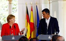 Sánchez y Merkel escenifican su sintonía con un frente común en inmigración