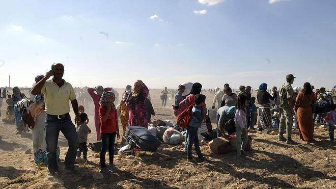 Unos 70.000 kurdos de Siria huyen a Turquía en las últimas 24 horas